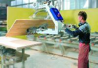 The lifter has 125kg capacity with 180°turning for loading CNC machines with sheets of wood.